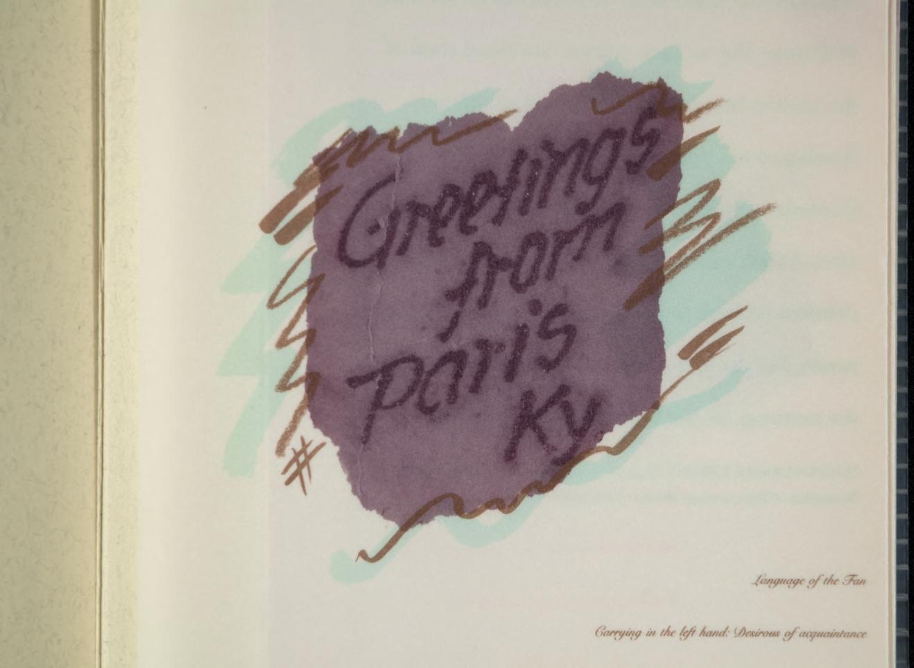 "Irregular purple shape in the center with darker purple text ""greetings from Paris Kentucky."" Brown and green marks accent the purple center piece."